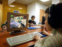 Teens play computer games in Lyon, France
