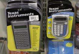 Texas Instruments says past 'shallow downturn' (AP)