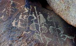 The ancient Aboriginal rock carving known as 'Climbing Man' (C)