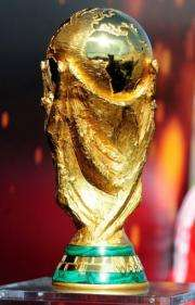 The FIFA World Cup trophy is displayed during a tour in Santiago