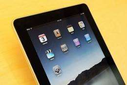 The iPad allows users to watch videos, listen to music, play games, surf the web or read electronic books