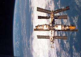 The Russian space station Mir orbits Earth in 1998