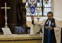 UK vicar invokes God's blessing on BlackBerrys (AP)