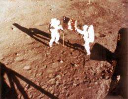 US astronaut Neil Armstrong (right) deploys the US flag on the surface of the moon