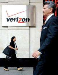 Workers pass by the Verizon building in New York City