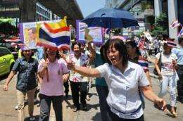 Writing online is easier than taking to the streets to express your opinion, like these peaceful Thai protesters