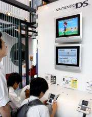 """Young boys play Japanese video game giant Nintendo's portable video game console """"Nintendo DS"""""""