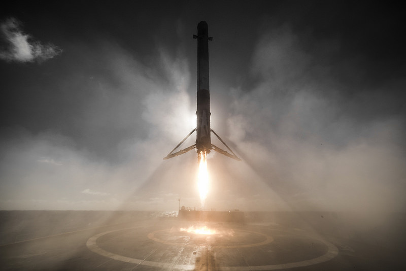 a stunning view of the falcon 9 rocket just before landing on a barge in the pacific ocean on january 14 2017 following the launch of 10 iridium next