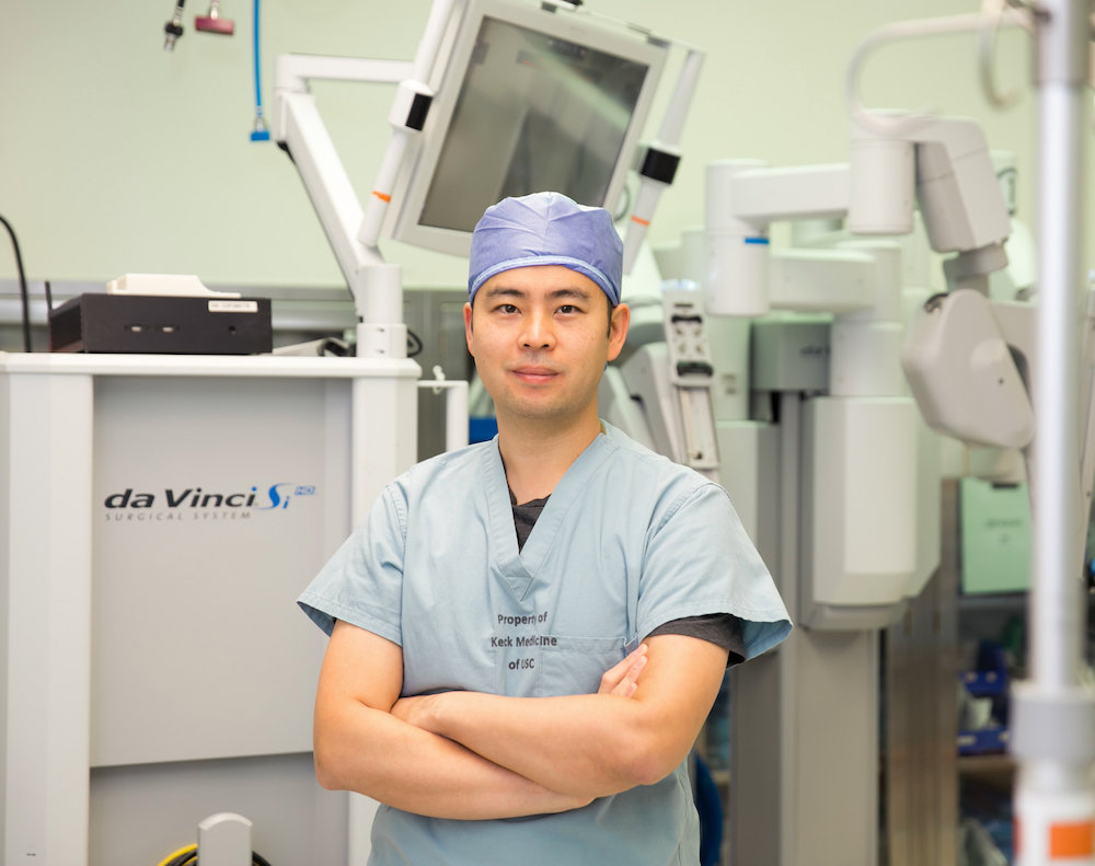 "Andrew Hung, M.D., with the ""black box"" recorder and da Vinci Surgical  System. Credit: Ricardo Carrasco III"