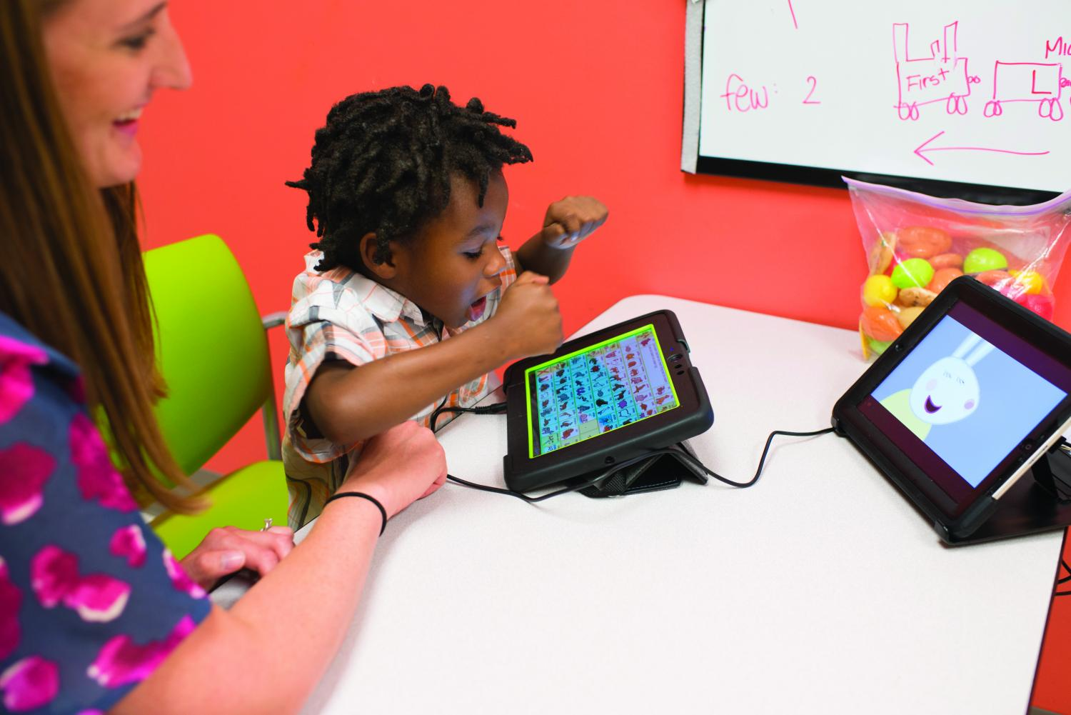 A Child With Autism Spectrum Disorder ASD Is Receiving Speech Therapy Many Children Respond To Specific Apps For Tablets And Devices