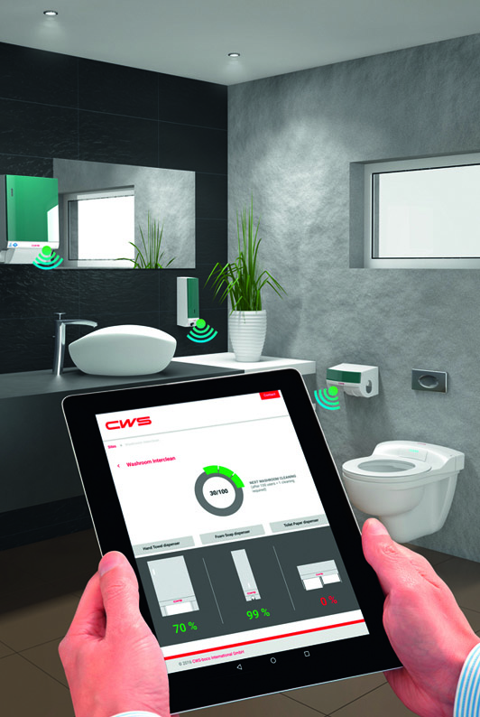 Checking Dispensers With A Tablet Computer In A Networked Washroom. Credit:  CWS Boco International GmbH