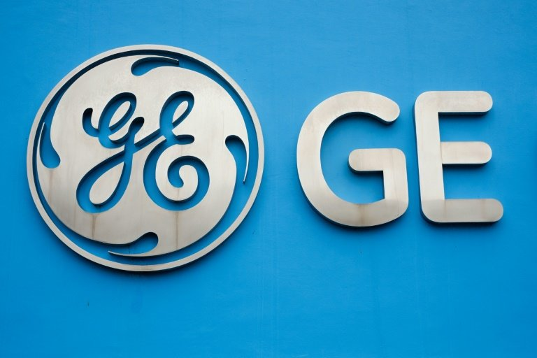 ge reports 4q loss of 9 8 bn on insurance tax charges