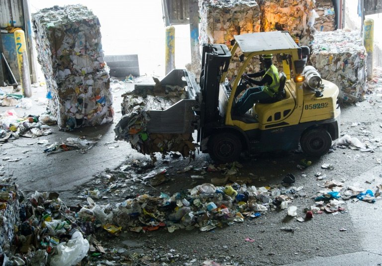 A Boy Scavenges Bottles At Trash Disposal Area Outside Of Constanza Dominican Republic