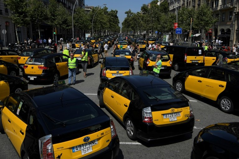 Image result for Madrid taxis block access to tourist fair in anti-Uber protests