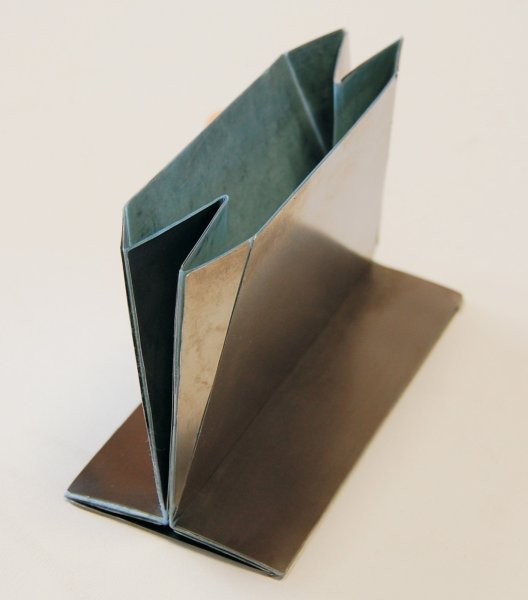Origami Solution Found For Folding Steel Shopping Bags