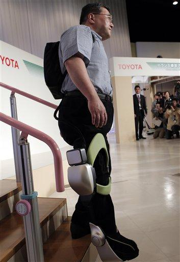 toyota shows machines to help sick  elderly move