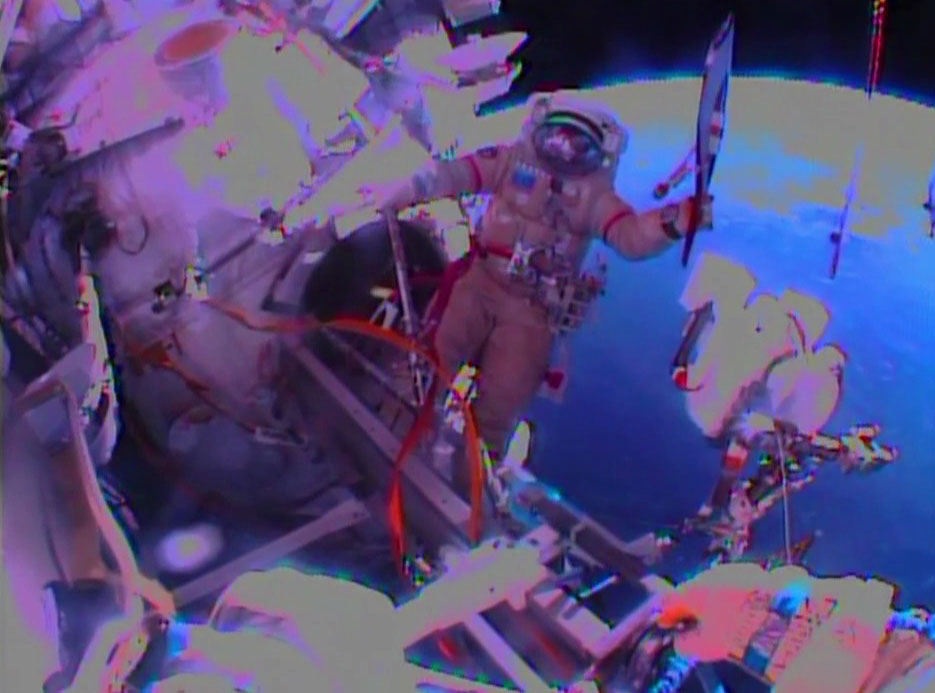 Russians Take Olympic Torch On First Ever Spacewalk