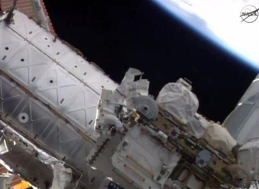 Astronauts resume routine spacewalks for NASA (Update)