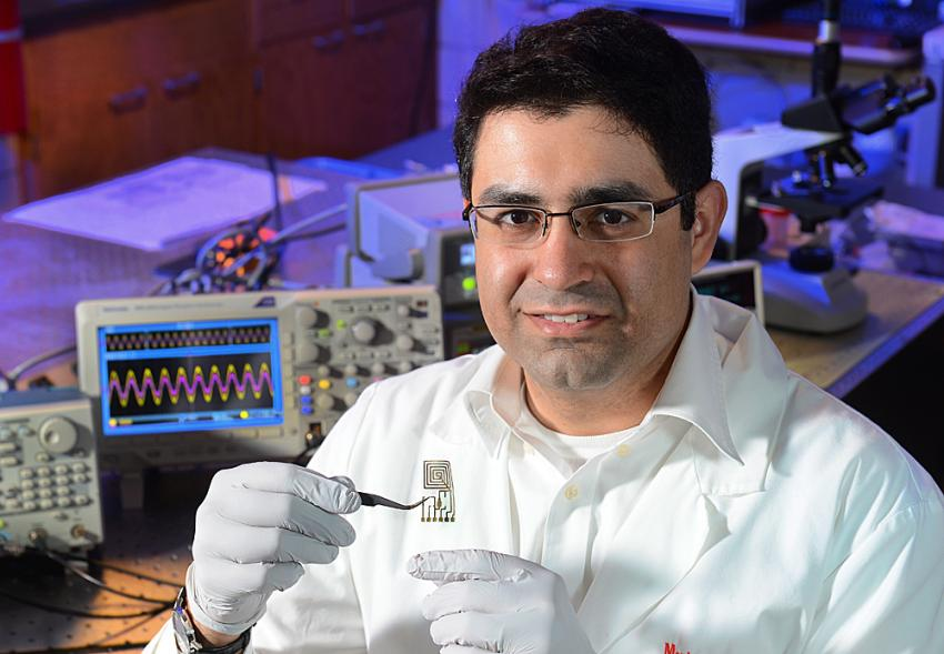 scientist developing materials electronics that dissolve when triggered