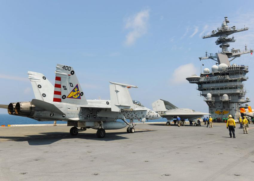 navy tests drone landings on aircraft carrier along with