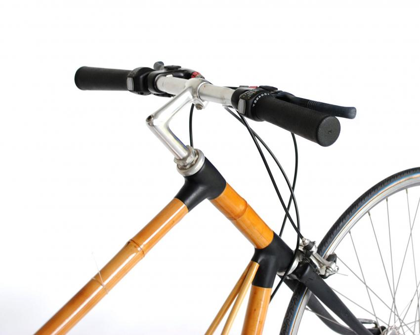 Bamboo bike recharges mobile devices and external batteries by pedaling