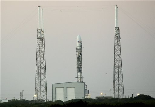 spacex launch of observatory landing test off until tuesday