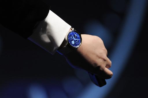 huawei smartwatch on wrist. chinese electronics group huawei, one of the firms seeking to seduce buyers with internet-connected devices, shows off its new smartwatch in barcelona on huawei wrist