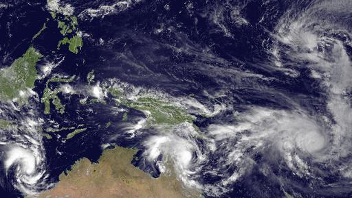 image taken by the jma mtsat 2 satellite at 0330z on march 11 2015 shows three tropical cyclones spreading from the indian ocean to the pacific ocean