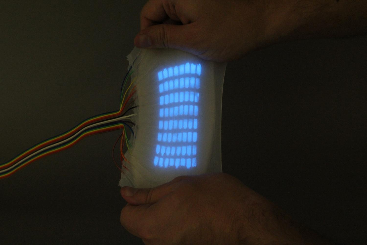 'Octopus-like' skin can stretch, sense touch, and emit light (w/ Video)