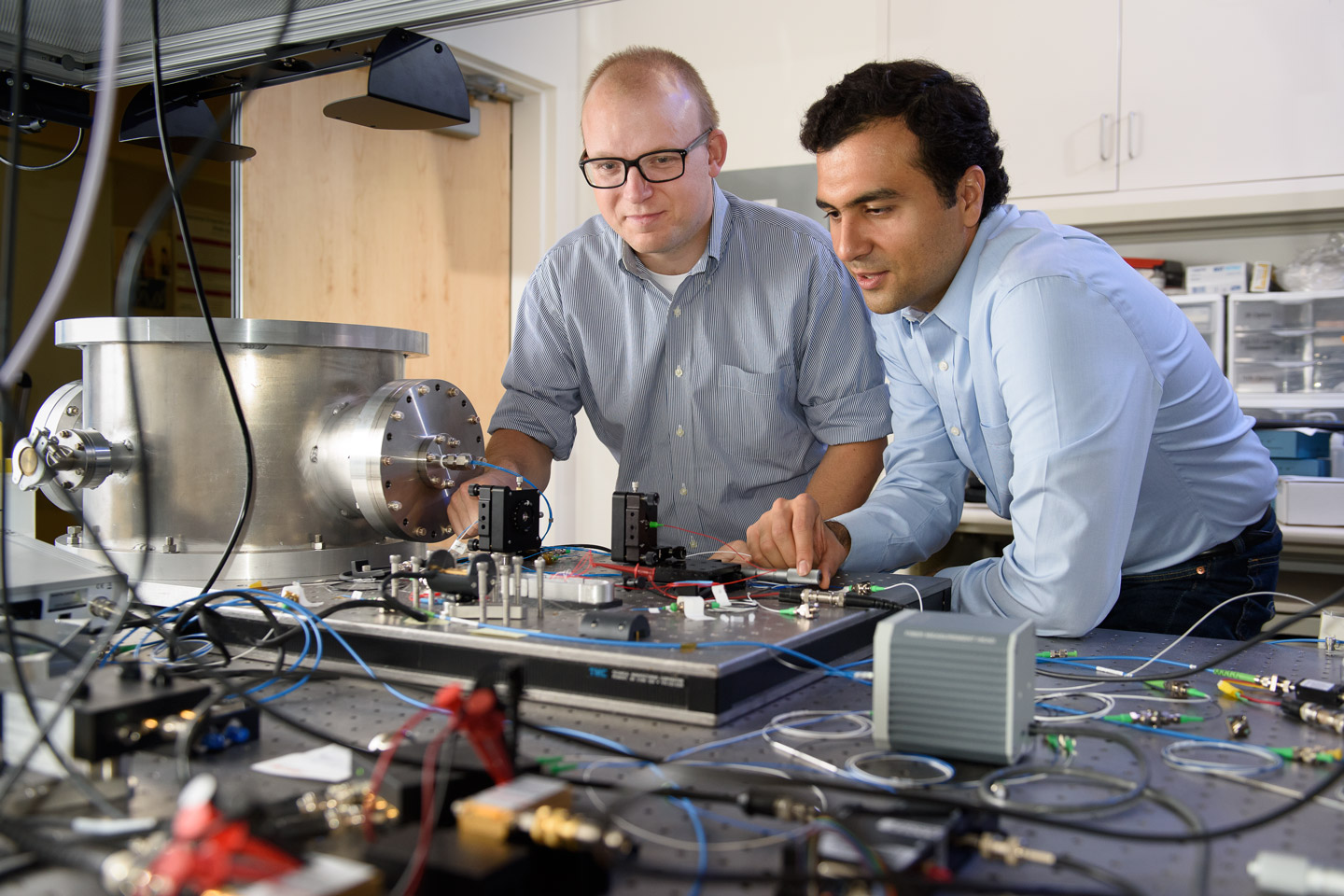 Researchers Create A New Type Of Computer That Can Solve Problems Electrical Circuits Archives Solved Post Doctoral Scholar Peter Mcmahon Left And Visiting Researcher Alireza Marandi Examine Prototype Light Based