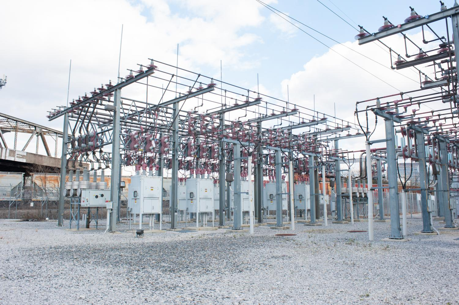 power grid Power grid definition is - a network of electrical transmission lines connecting a multiplicity of generating stations to loads over a wide area.