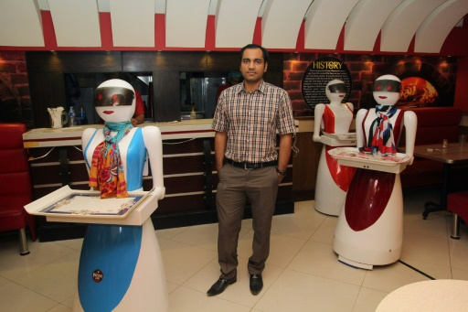 Pizza bytes pakistan enchanted by first robot waitresses in this photograph taken on july 4 2017 pakistani engineer osama jafari c poses with robot waitresses annie l rabia r and jennie background at m4hsunfo