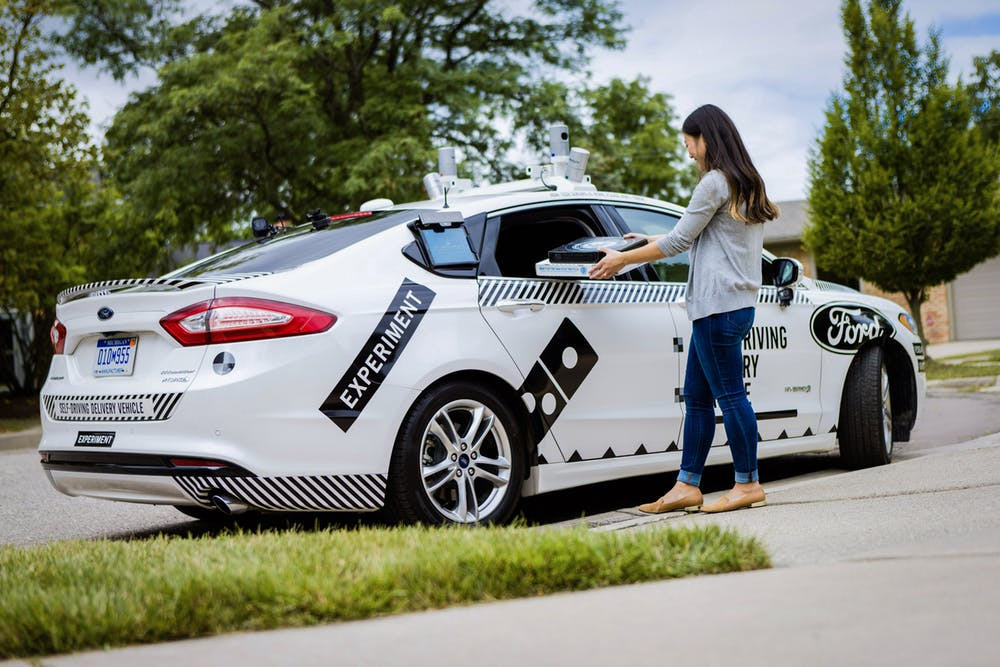 Pizza delivery by robot cars has arrived with big questions dominos and ford are testing whether people will go to the driveway or curb to get their pizza credit handout malvernweather Images