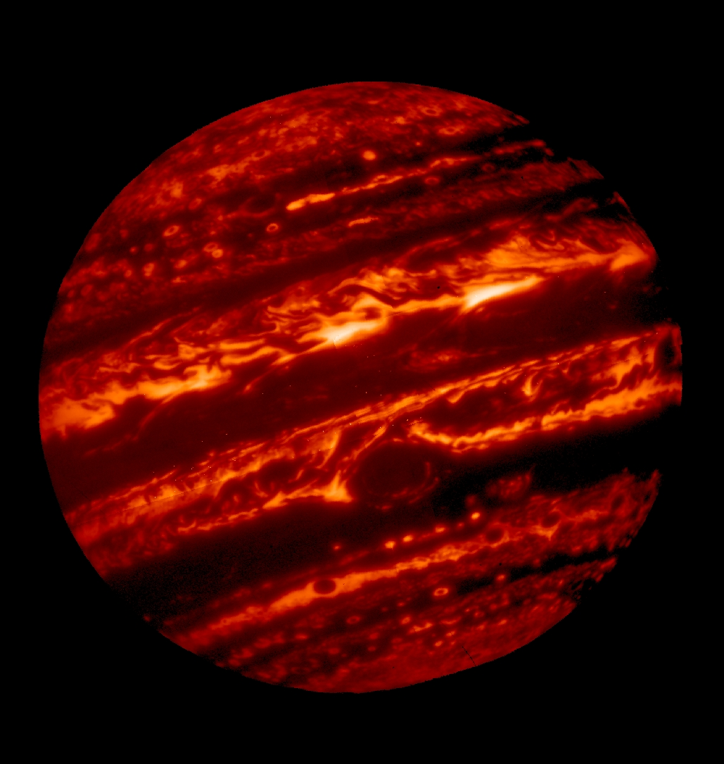 At longer infrared wavelengths, Jupiter glows with thermal (heat) emission.