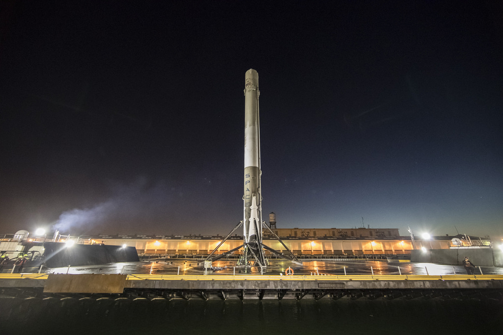the falcon 9 booster sitting successfully on the barge after landing credit spacex