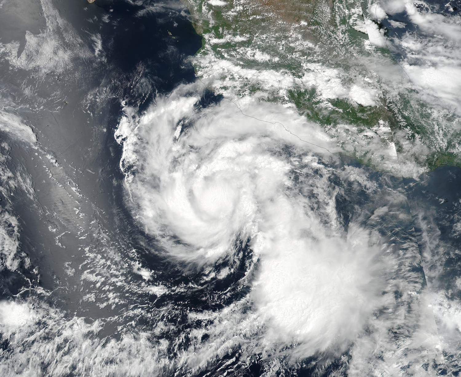 Two hurricanes, tropical storm in Pacific far off Mexico coast