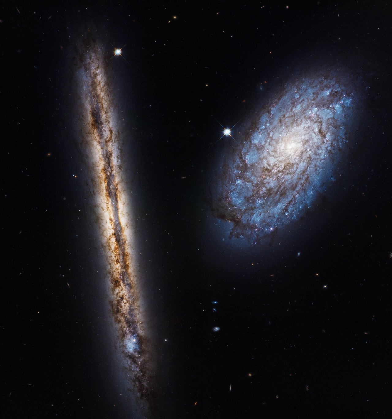 Hubble celebrates 27 years with two close friends