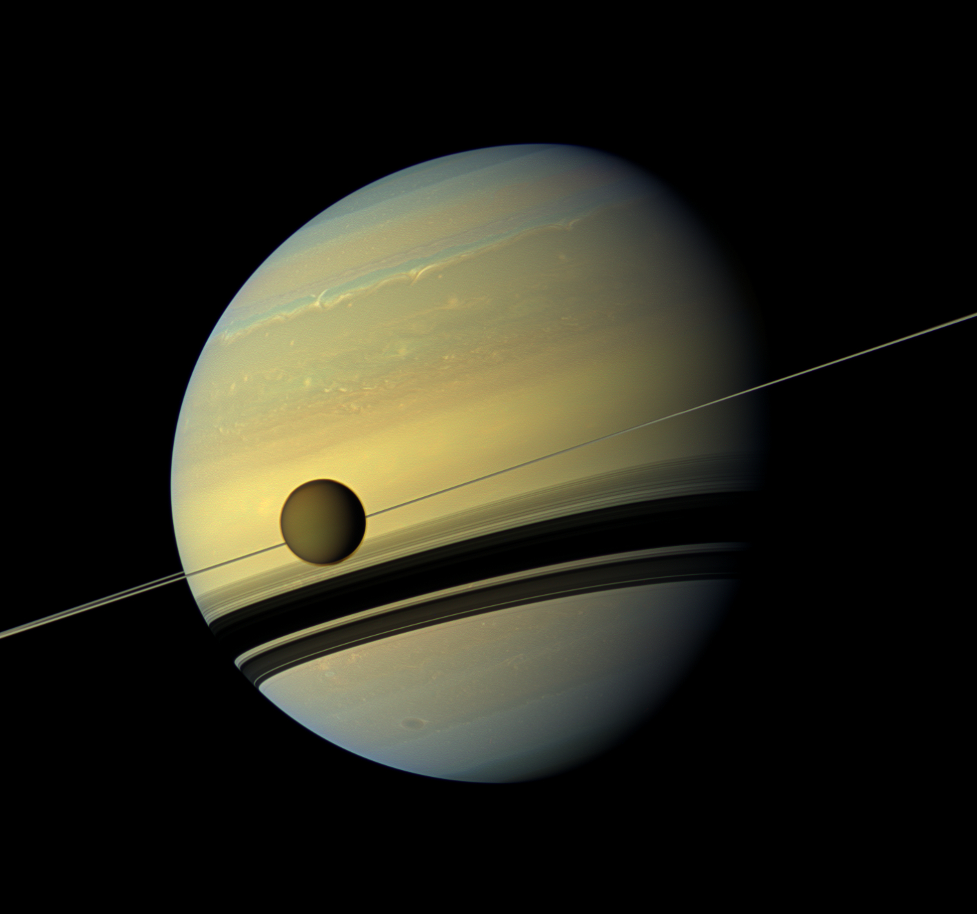 Scientists find moon of saturn has chemical that could form membranes this cassini image from 2012 shows titan and its host planet saturn credit nasajpl caltechssi thecheapjerseys Images