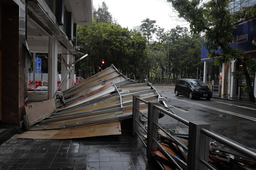 Powerful typhoon kills at least 3 in macau - China southern airlines hong kong office ...