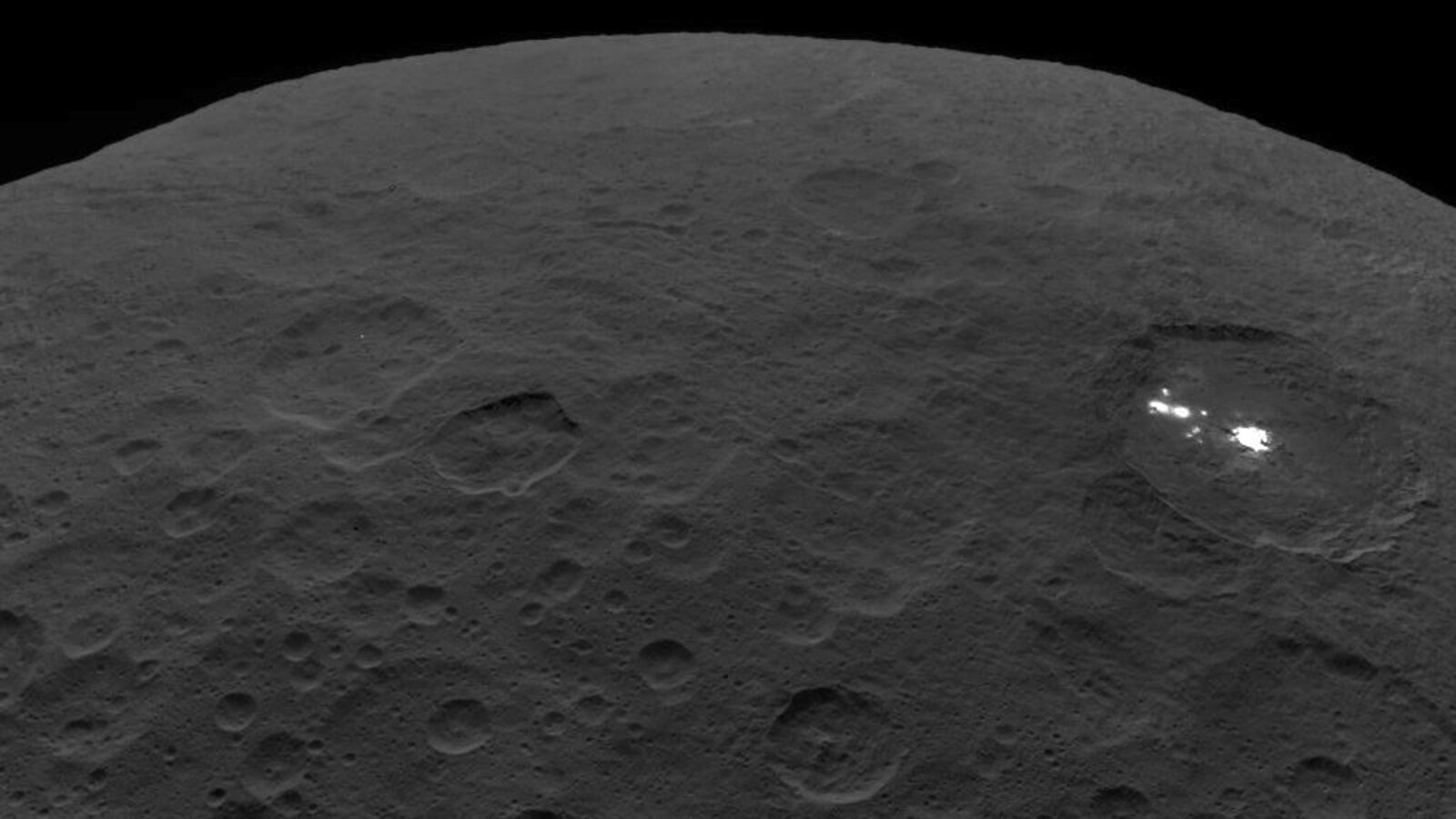 Insulating crust kept cryomagma liquid for millions of years on nearby dwarf planet