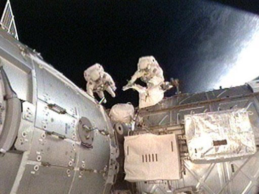 Astronauts return to Earth on Russian spacecraft
