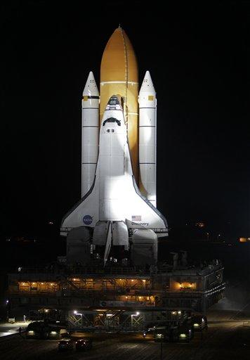 Space shuttle Discovery fixed, back on launch pad